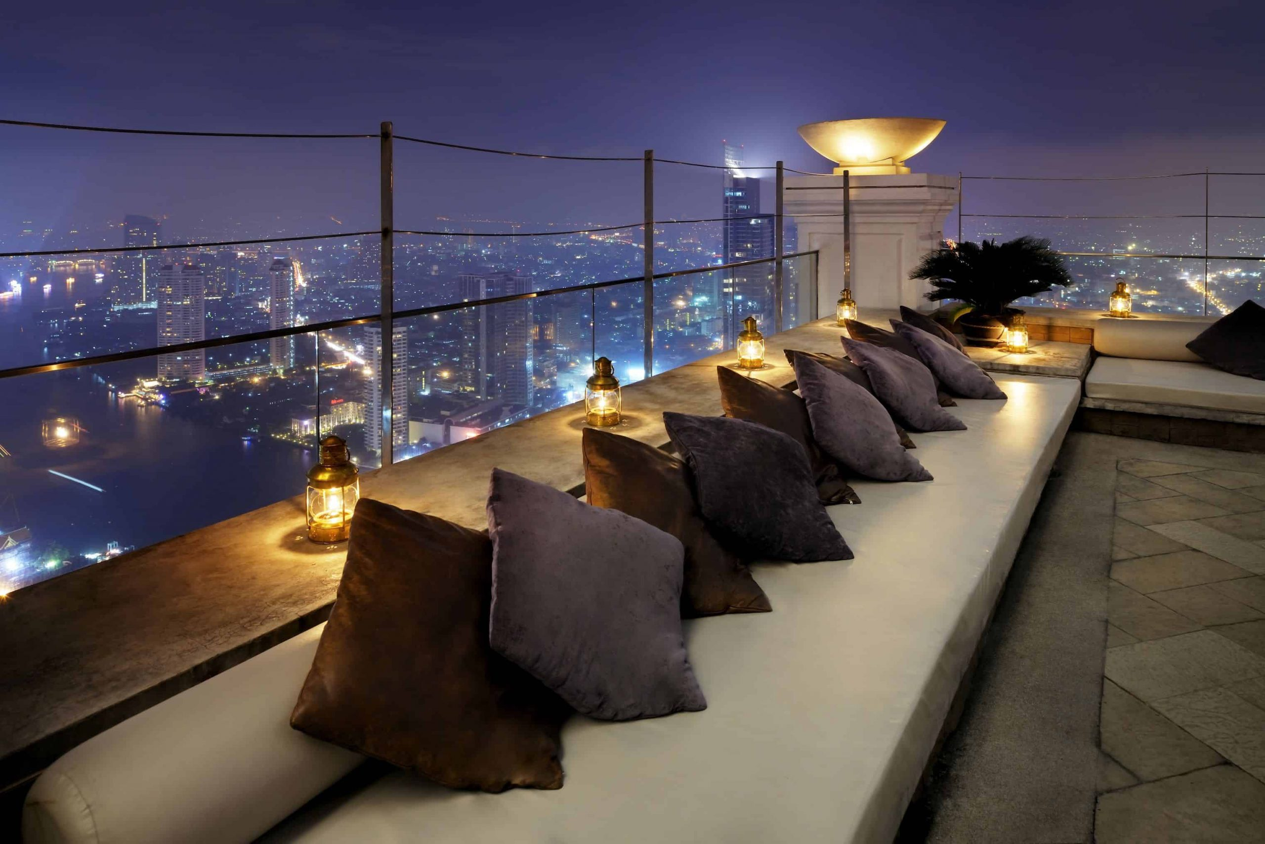 white couch with pillows on edge of terrace