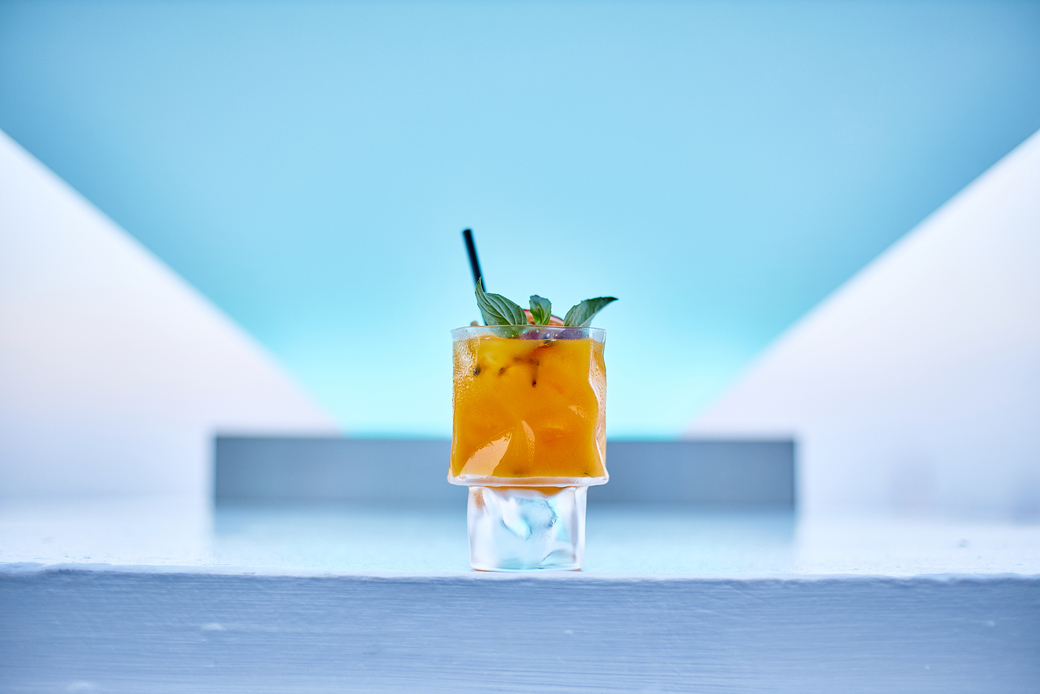 Single drink against a blue backdrop