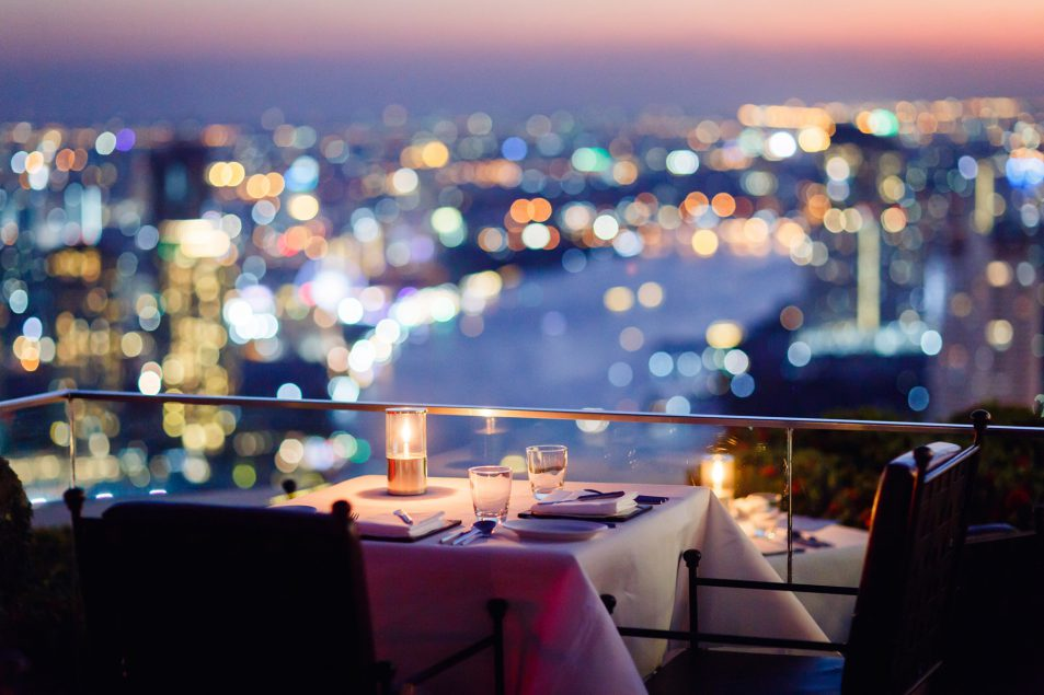 Table at Sirocco with an sunset view of the city
