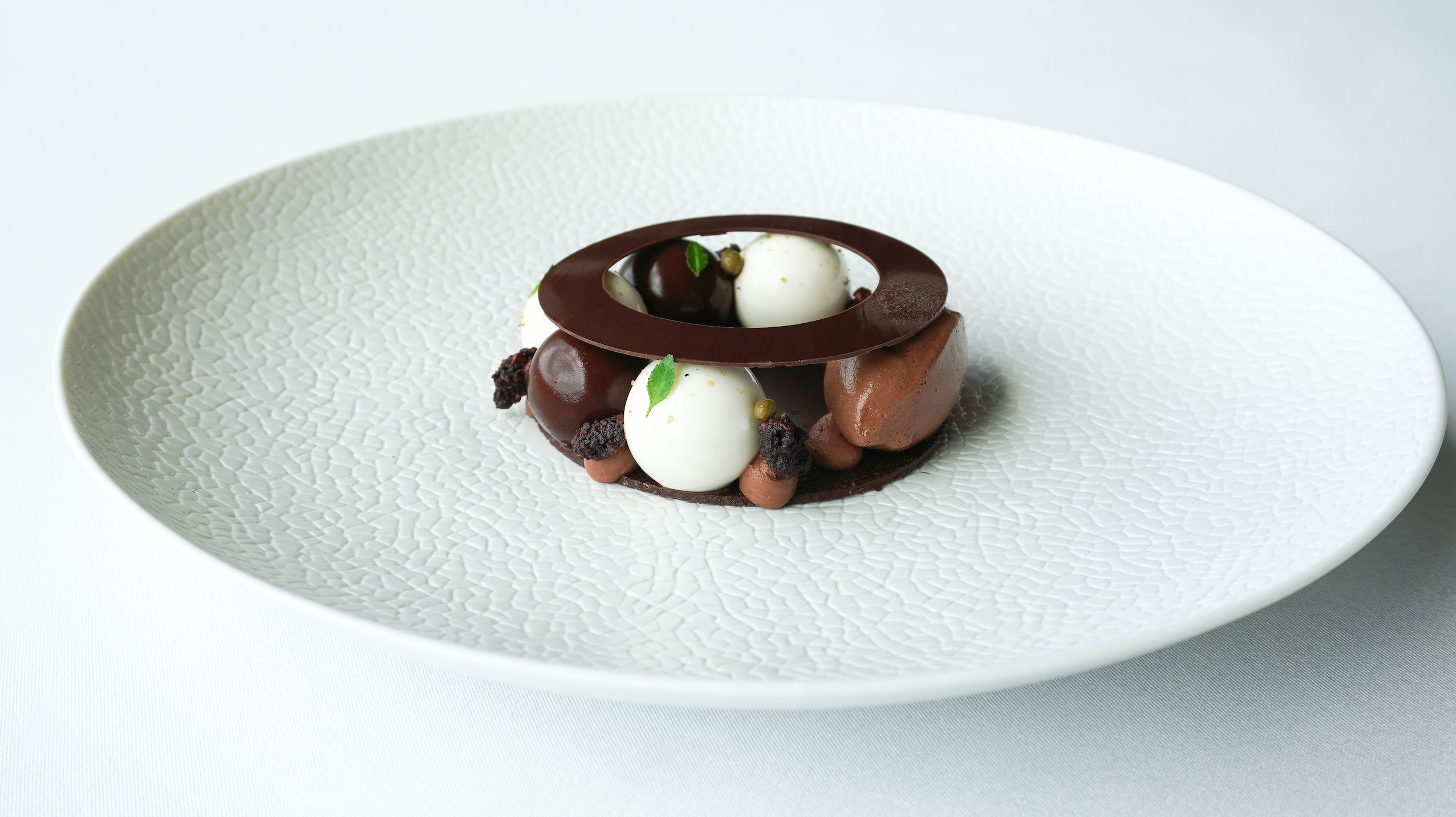 chocolate desert on round white plate