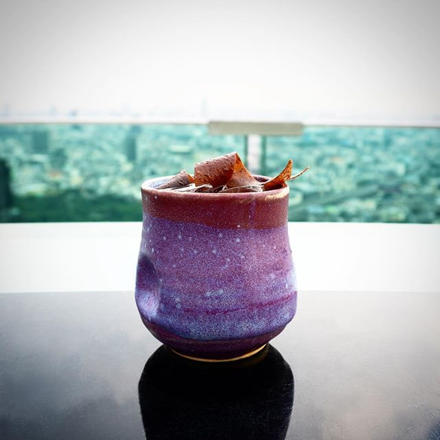 Cocktail with city in background