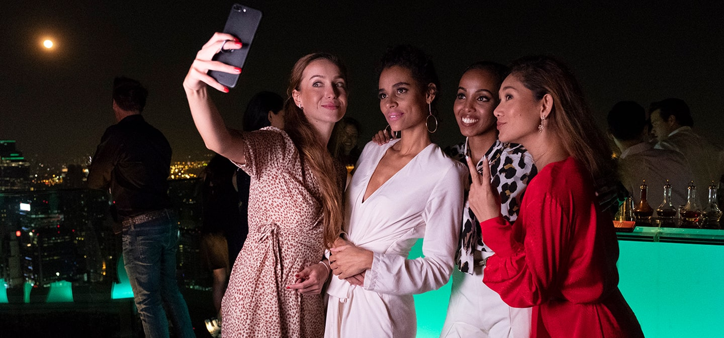 Happy ladies taking selfie