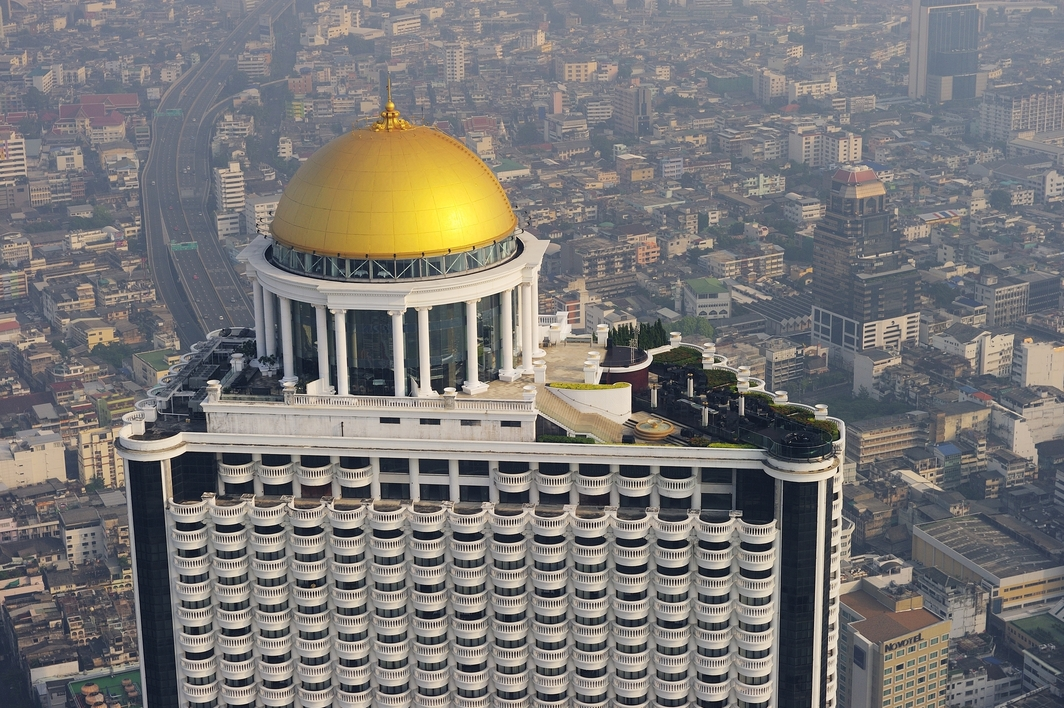 tall building with yellow dome and terrace