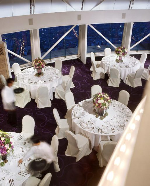 ballroom with dinner tables flower centre pieces purple carpet