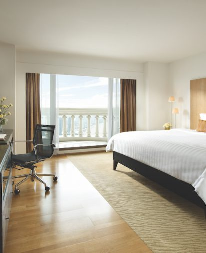 King size bed balcony and desk with chair