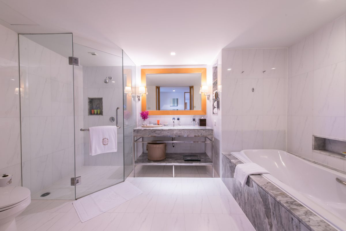 marble sink mirror bathtub on right side shower on left side