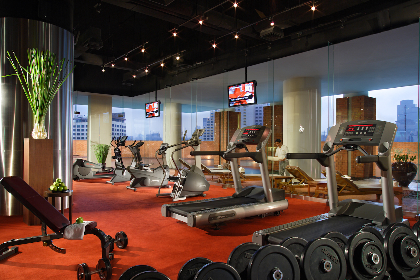 Hotel gym with treadmills and weights