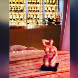 small pink sculpture of woman