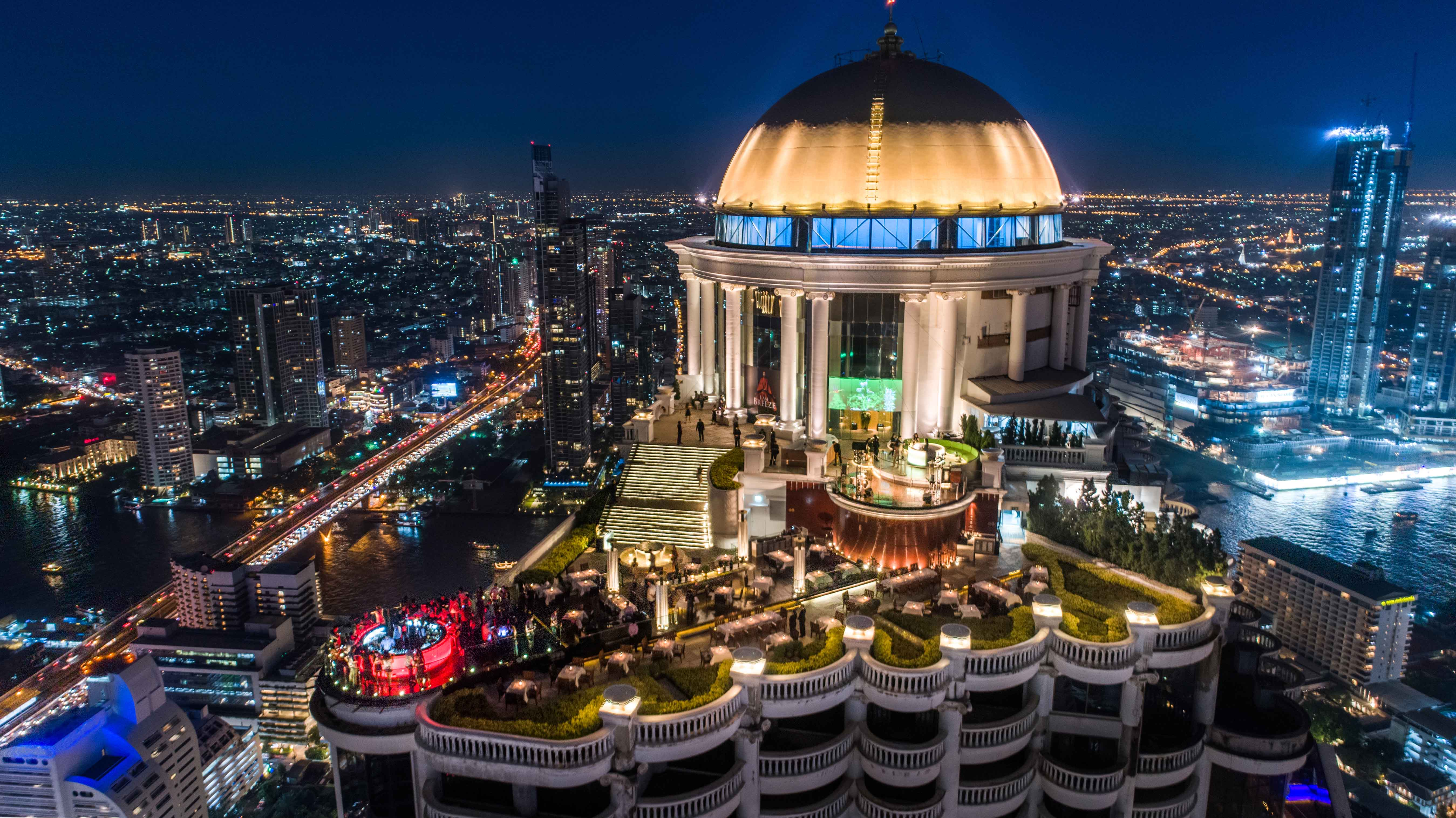 lebua rooftop at night from afar surrounded by city lights