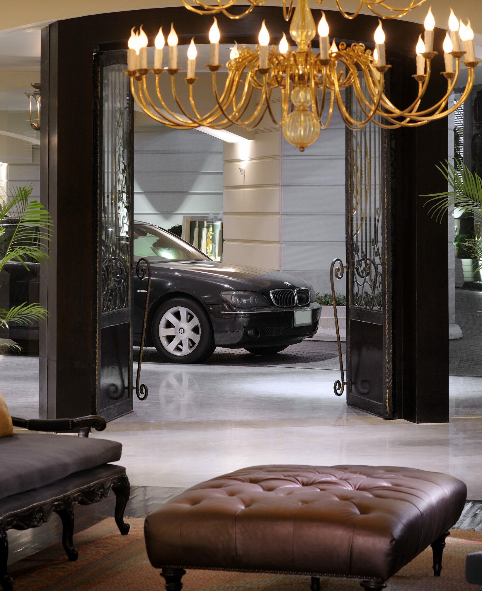 Hotel lobby with couch and car in the back