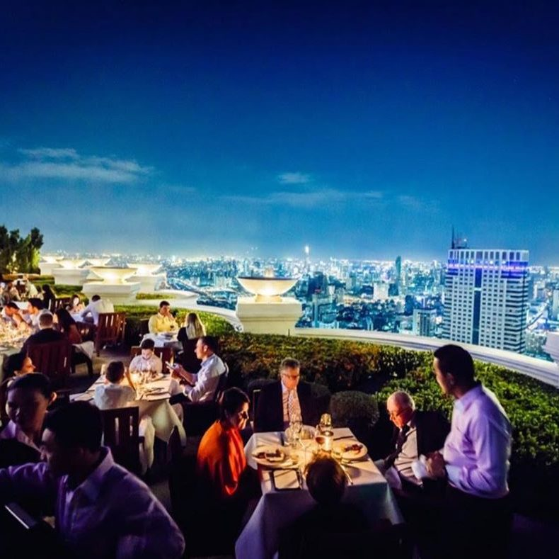 people eating on a rooftop restaurant