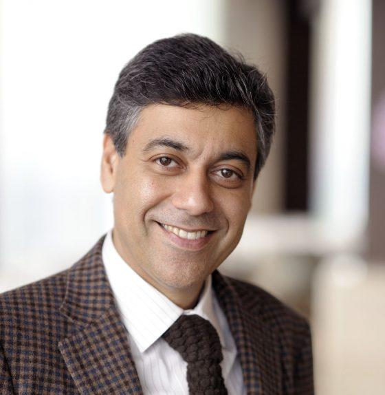 Head Shot man in brown suit smiling